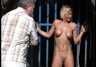 Outdoor whipping of blonde wife in