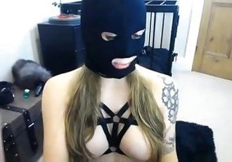 Tatooed babe in mask fucked with