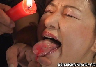 Busty Japanese chick in hot wax