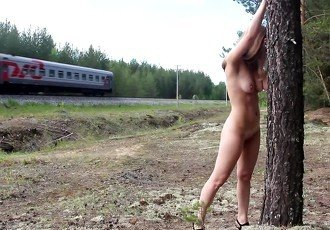 Tied girl to the tree, near the