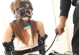 Blindfolded and masked Asian girl